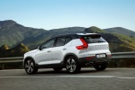2020 Volvo XC40 T5 R-Design AWD in Crystal White Metallic - Driving Rear Left Three-quarter View
