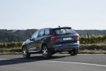 2018 Volvo XC60 T6 AWD in Denim Blue Metallic - Driving Rear Left Three-quarter View
