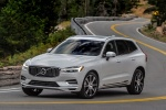 2018 Volvo XC60 T8 eAWD in Crystal White Metallic - Driving Front Left Three-quarter View
