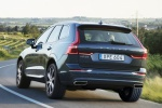 2019 Volvo XC60 T6 AWD in Denim Blue Metallic - Driving Rear Left View